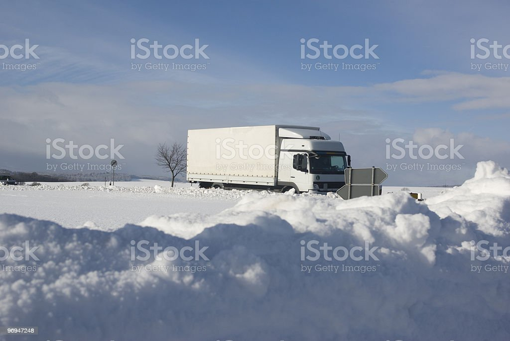 White truck driving on a wintry road royalty-free stock photo