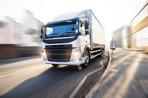 White Truck in motion isolated with clipping path