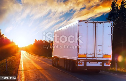 istock White truck on a road in the polar night 495673442