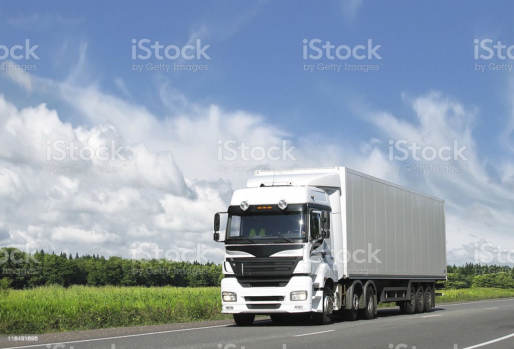 white truck on highway under blue sky royalty-free stock photo