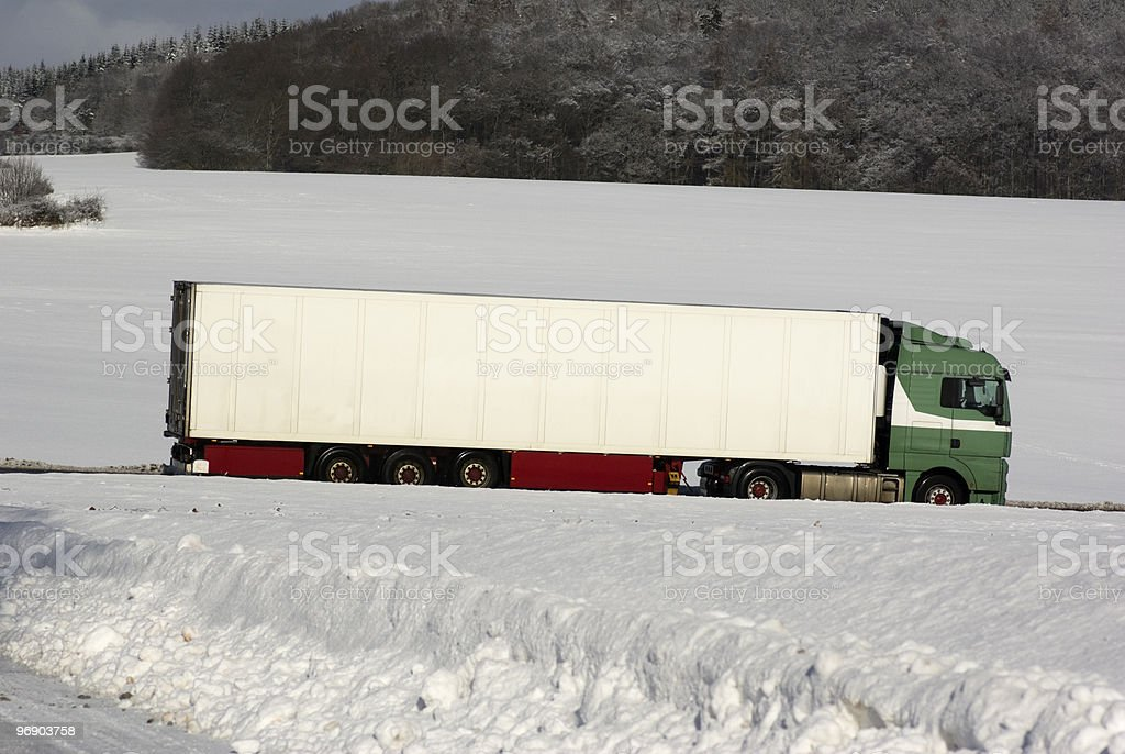 White truck on the Federal road in snow- covered landscape royalty-free stock photo