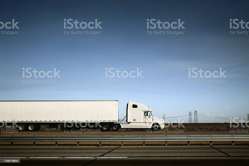 White truck on the road under blue sky stock photo