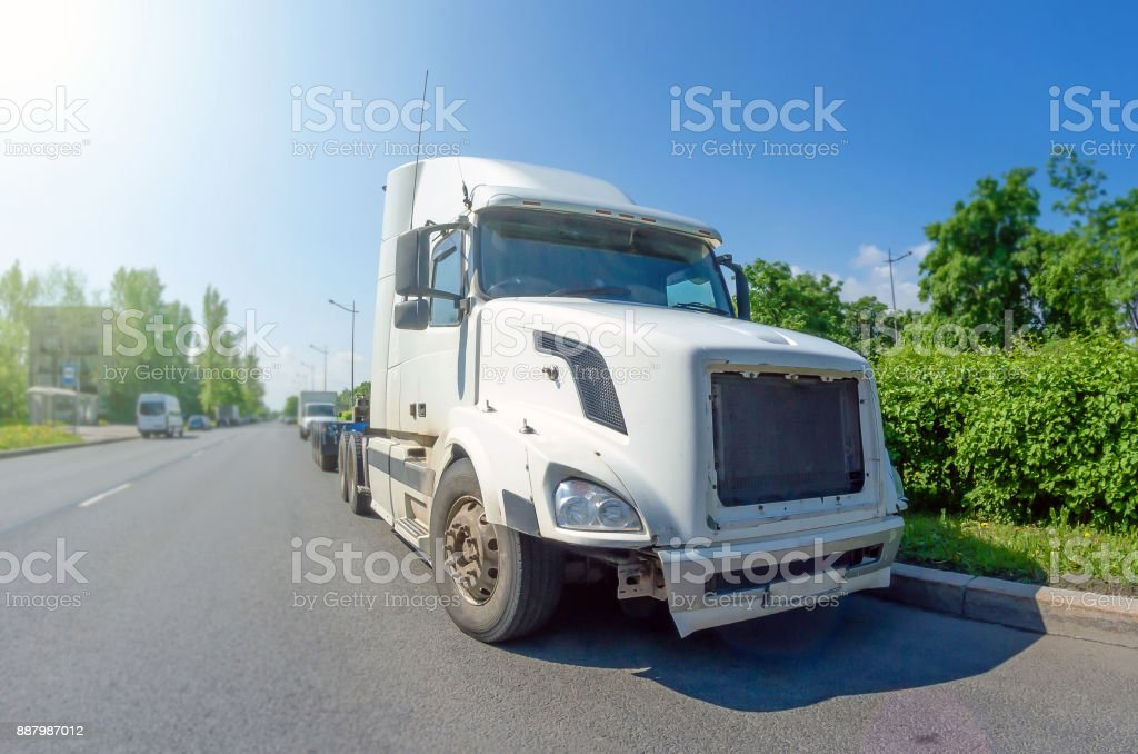 White truck without trailer and cargo on the road. stock photo