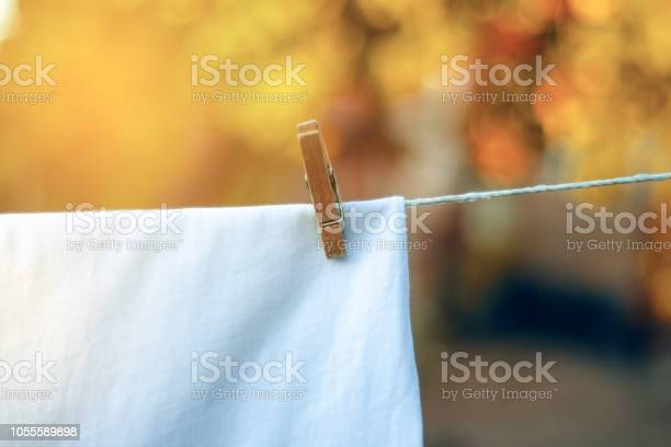 White tshirt hanging on a clothespin nature picture id1055589898?b=1&k=6&m=1055589898&s=612x612&h=t8chs  2j1bupq7nyrzoyly1ki3kx3hlhxa49xj8lak=