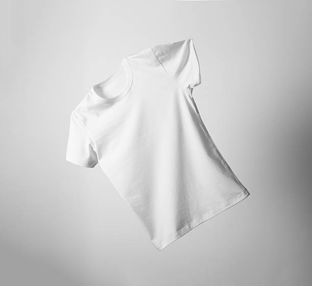 White T-Shirt Mock-up White T-Shirt flying freely in the air. white t shirt stock pictures, royalty-free photos & images
