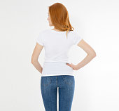 istock white t-shirt on a smiling girl : back view. Red hair woman with empty tshirt mock up 1219981489