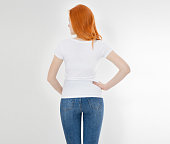 istock white t-shirt on a smiling girl : back view. Red hair woman with empty tshirt mock up 1223843854