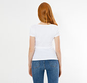 istock white t-shirt on a smiling girl : back view. Red hair woman with empty tshirt mock up 1223843855