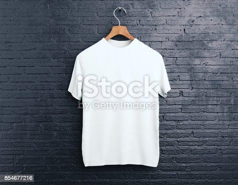 istock White t-shirt on brick background 854677216