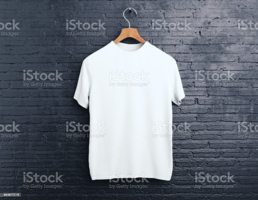 White t-shirt on brick background stock photo
