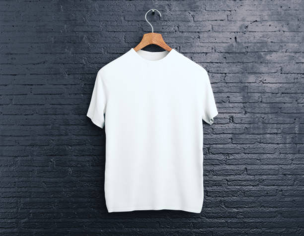 white t-shirt on brick background - t shirt stock photos and pictures
