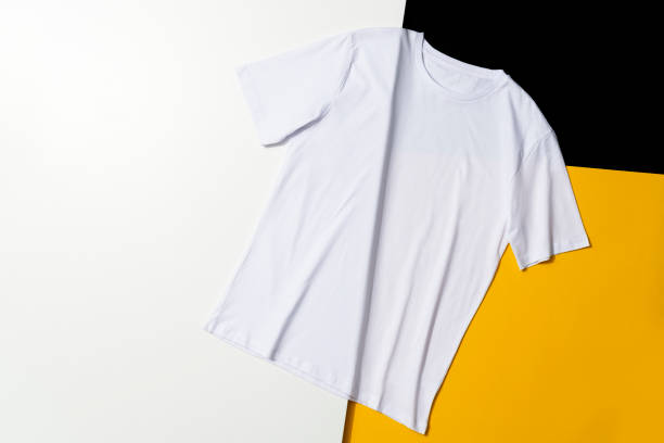 White t-shirt on colored background stock photo