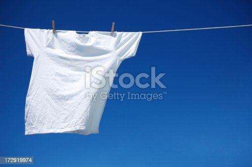 Picture of a white t-shirt drying on the rope.See Also: