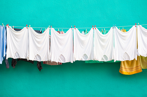 White t-shirts hanging on a clothesline