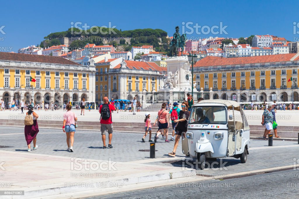 White Tuk Tuk taxi cab stands in Lisbon - foto stock