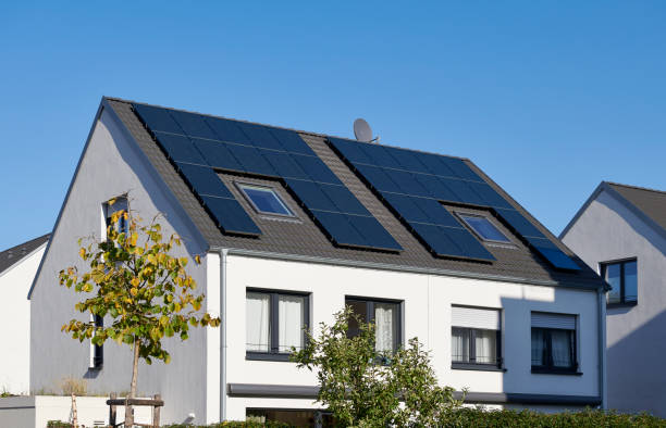 White twin house with solar panels on the roof stock photo