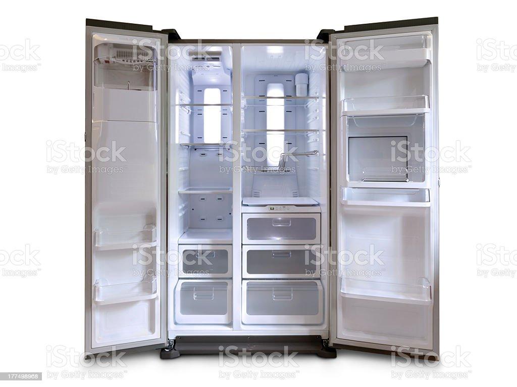 White two-door refrigerator with doors open wide stock photo