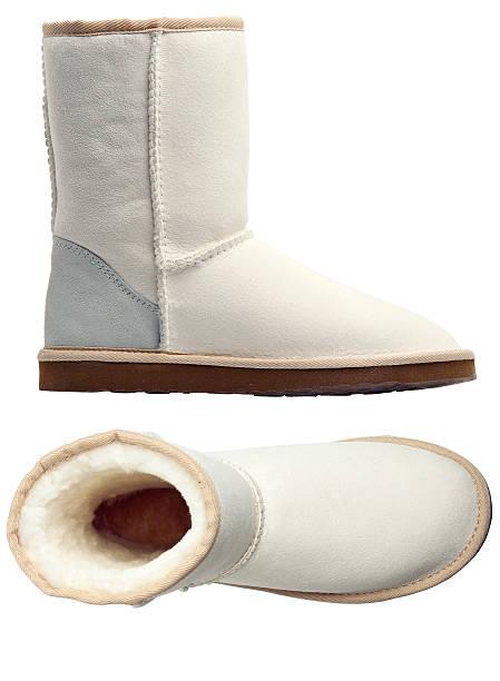 white uggs, an der seite und aussicht - lammfellstiefel stock-fotos und bilder