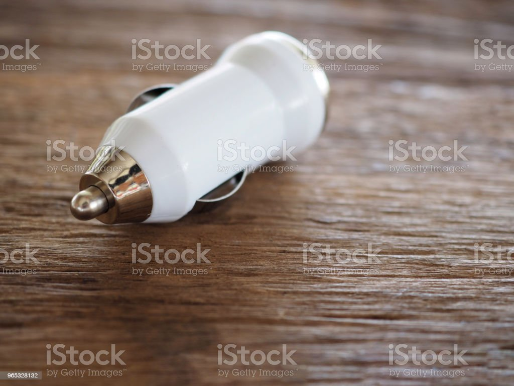 White USB Car Charger on a wooden board with technology and energy concept To facilitate And modern living zbiór zdjęć royalty-free