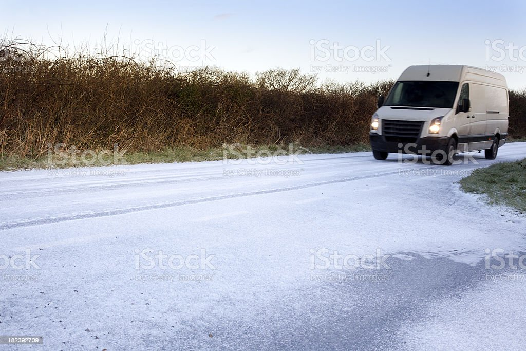 white van on icy road royalty-free stock photo