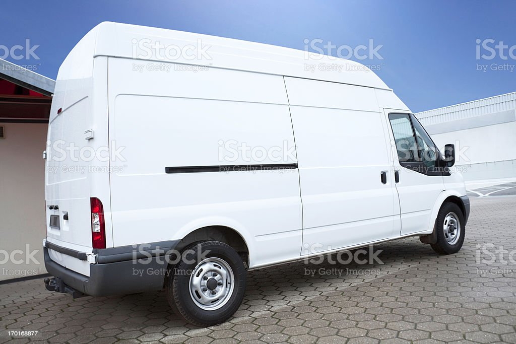 White Van on parking lot is waiting for next order stock photo