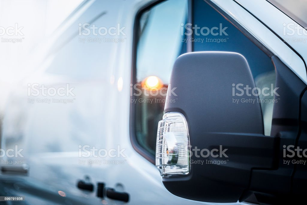 white van side view mirror stock photo