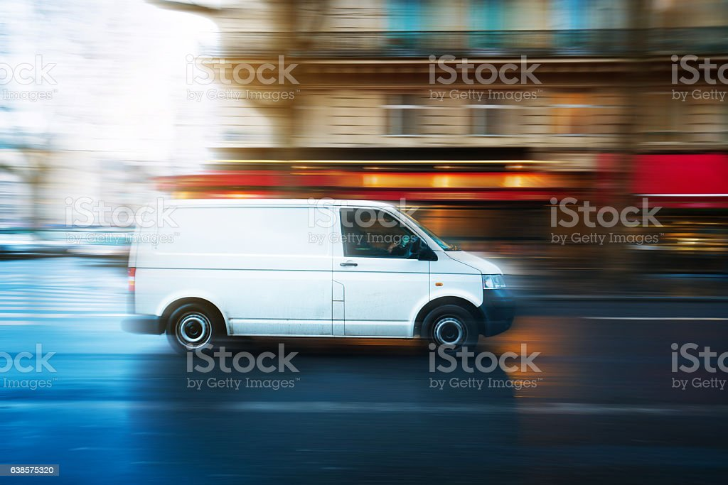 White van speeding in Paris stock photo
