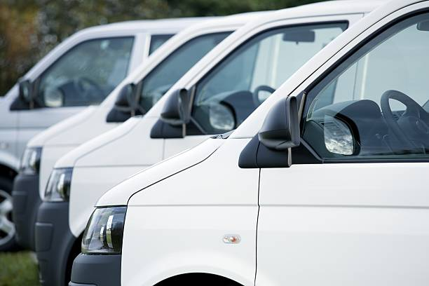 White vans in a row White Vans in Stock caravan photos stock pictures, royalty-free photos & images