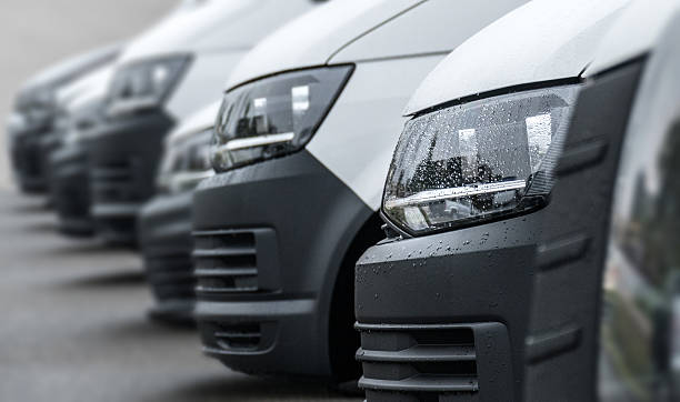 White vans in a row White van headlights commercial land vehicle stock pictures, royalty-free photos & images