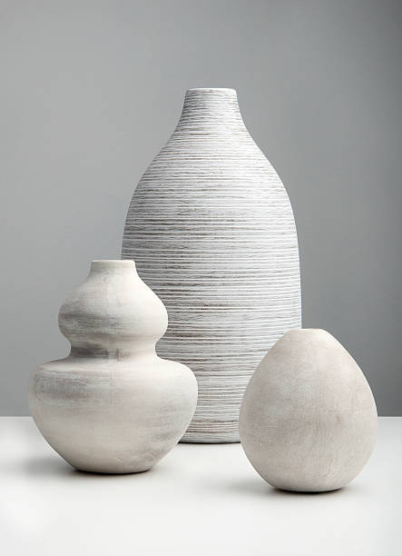 White Vases White Vases on a white surface ceramics stock pictures, royalty-free photos & images