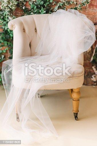 white veil the armchair