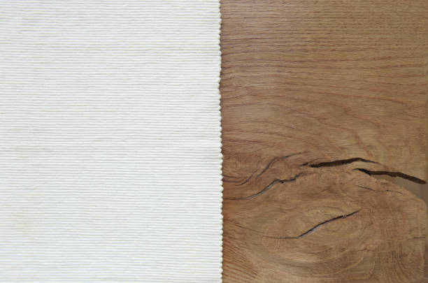 white velvet material from left side wooden table. - corduroy stock pictures, royalty-free photos & images