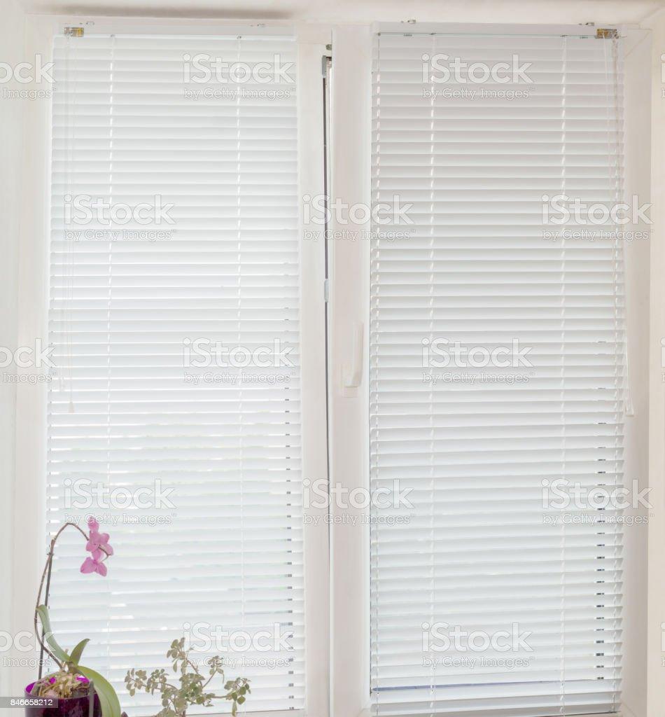 White Venetian blinds on a modern plastic window stock photo