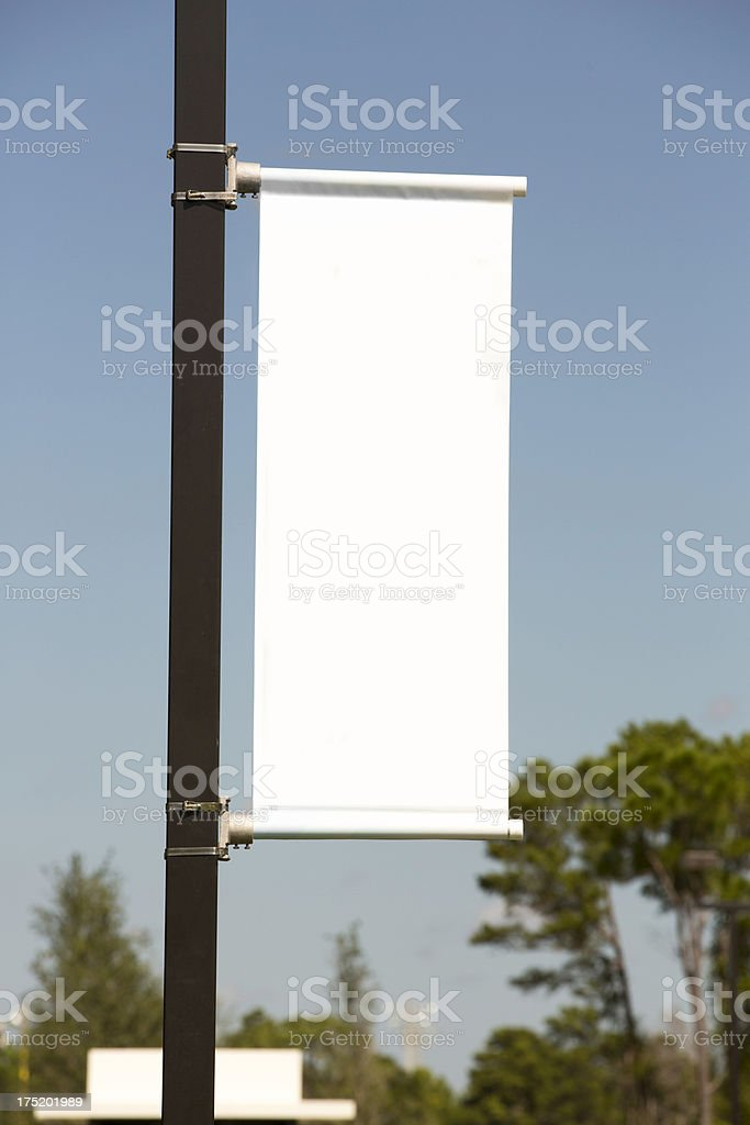 White vertical Banner against a Blue Sky stock photo