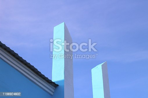white vertical columns rush into the blue sky. Abstract architectural modern photo