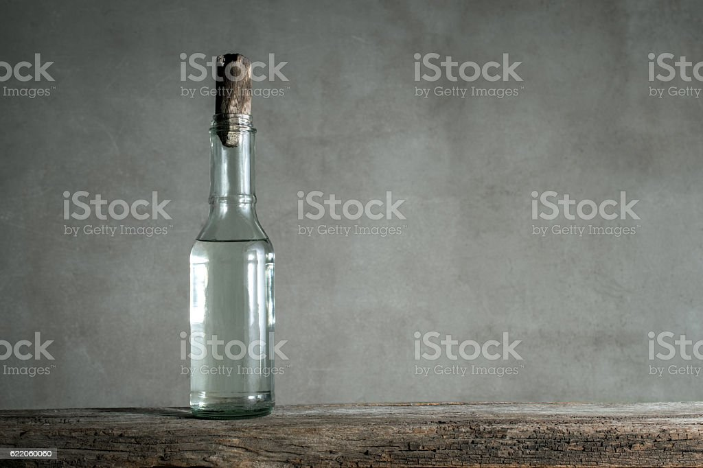 white vinegar bottle on wood table with copy space stock photo