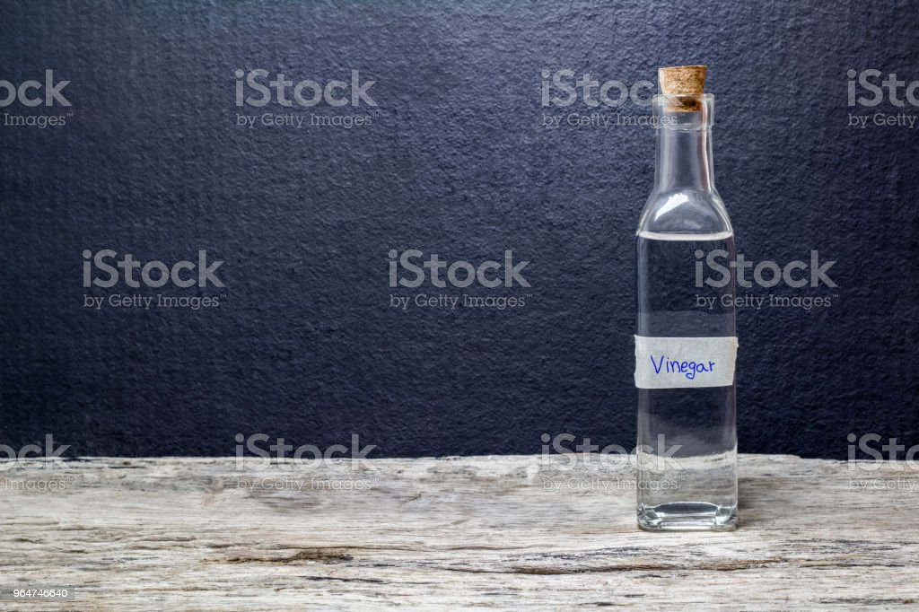 white vinegar on the wooden table royalty-free stock photo