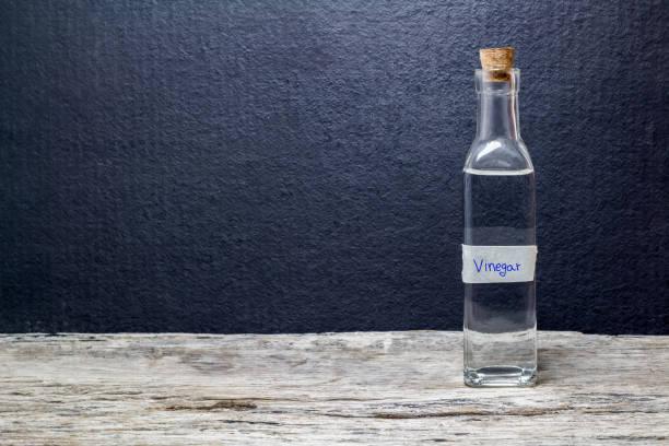 white vinegar on the wooden table white vinegar on the wooden table vinegar stock pictures, royalty-free photos & images