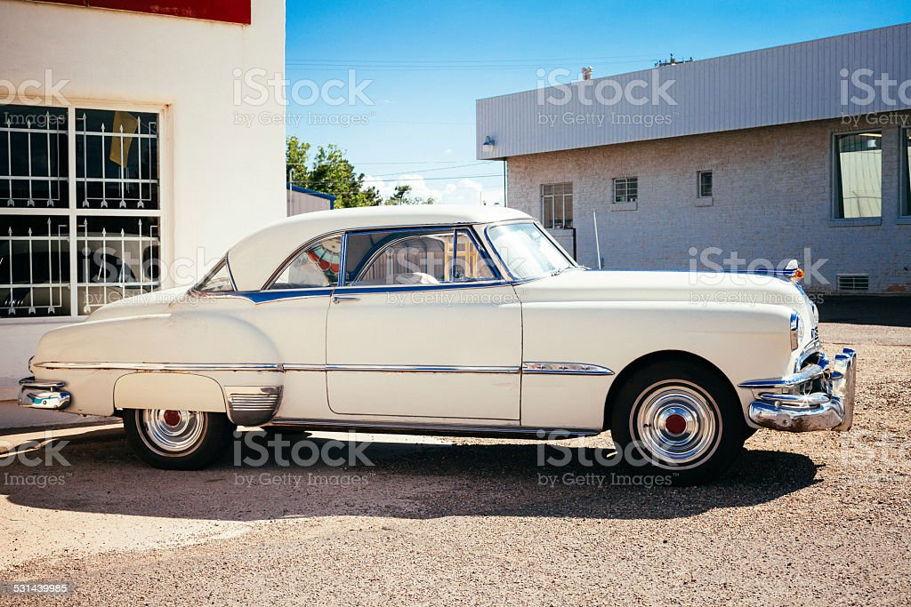 White Vintage American Car along the Route 66 stock photo
