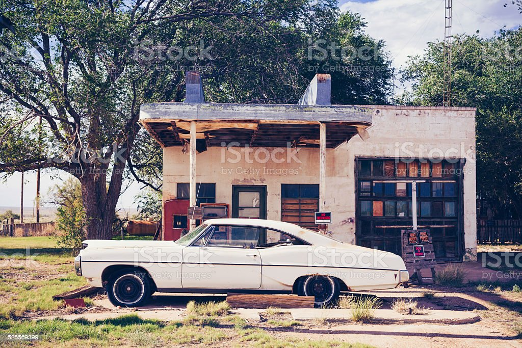 White Vintage American Car Reflected at Abandoned Gas Station stock photo