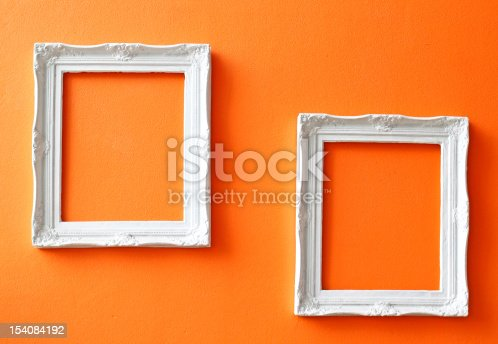 istock white vintage frames on orange wall 154084192