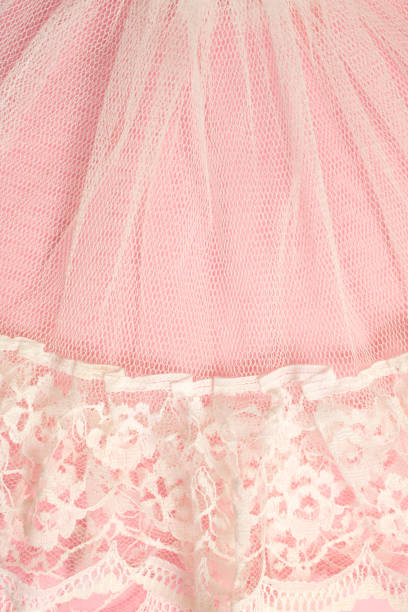 white vintage lace on pink background - petticoat stock pictures, royalty-free photos & images