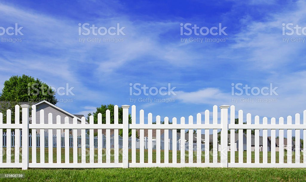 White vinyl fence and blue sky stock photo