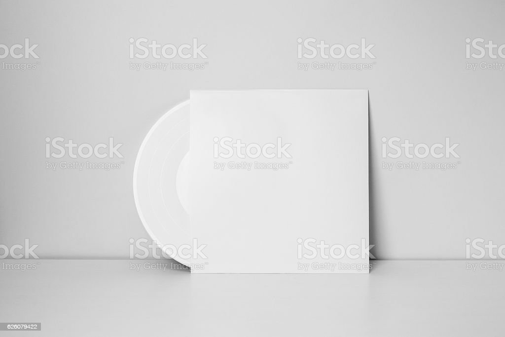 white vinyl record in paper case stock photo