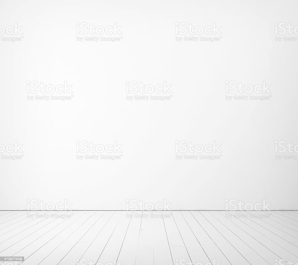 White wall and wood floor stock photo