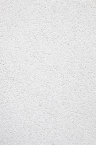 White painted concrete wall background/texture.