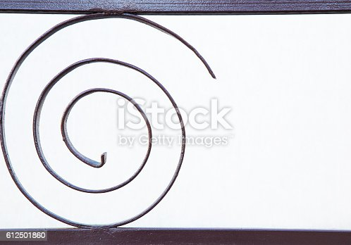 165581167istockphoto White wall background with rounded iron element. 612501860