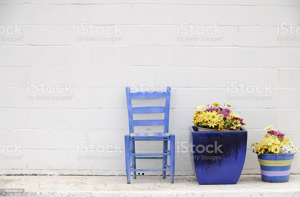 White Wall Blue Chair and Pots stock photo