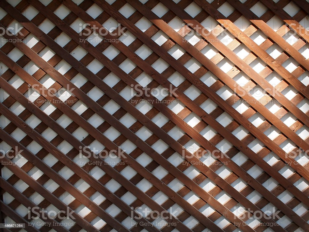 White wall covered with brown wood strips stock photo