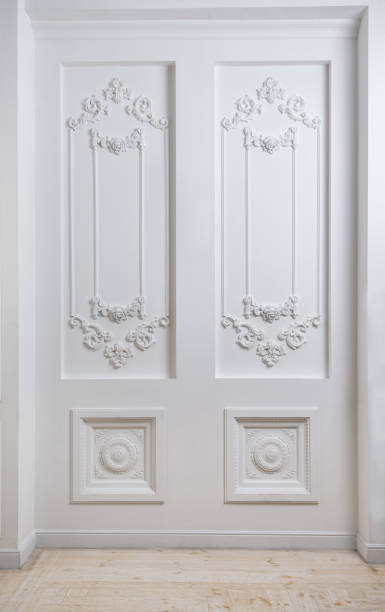 White wall decorated with classic fretwork stock photo